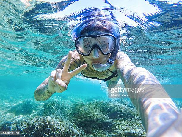 Young woman swimming with mask snorkeling