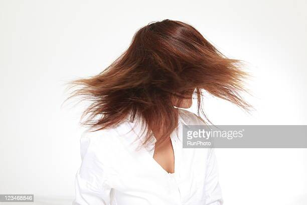 young woman swinging hair