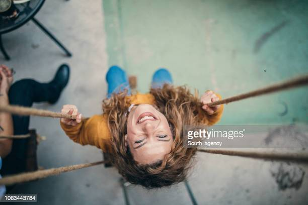 young woman swinging - swinging stock pictures, royalty-free photos & images