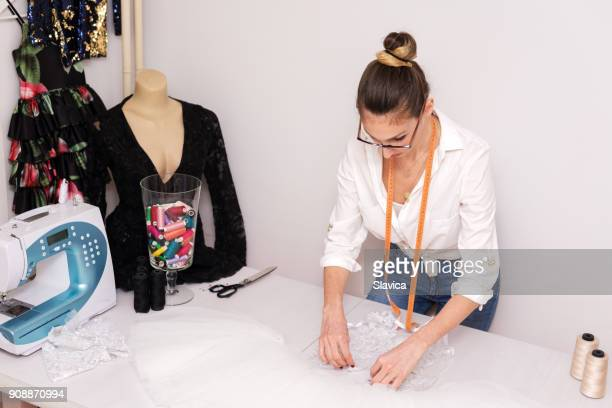 young woman tailor making white ballerina costume - blouse stock pictures, royalty-free photos & images