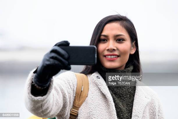 young woman take is selfie, helsingborg, sweden - helsingborg stock pictures, royalty-free photos & images