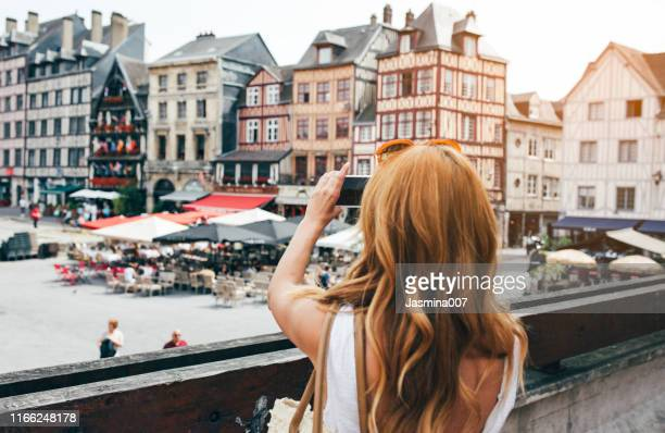 young woman take photos in rouen - rouen stock pictures, royalty-free photos & images