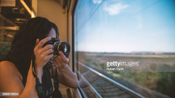 Young woman takes a picture at the train