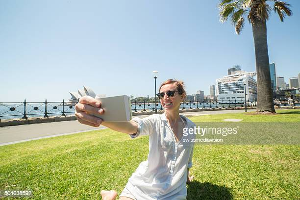 Young woman takes a selfie portrait in Sydney