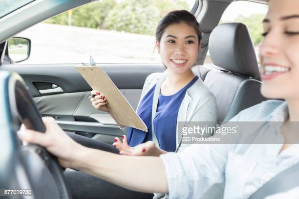 Young woman takes driving test