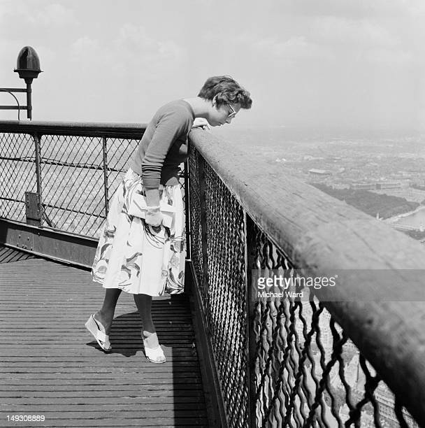 A young woman takes in the view from the Eiffel Tower in Paris 1959