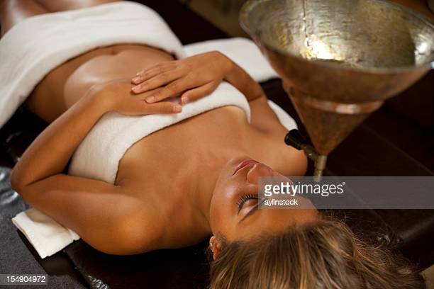 Young woman taking a ayurveda spa massage