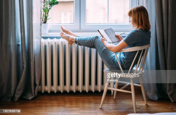 a young woman taking a break from technology - resting stock pictures, royalty-free photos & images