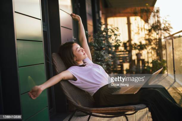 young woman taking a break from work - relaxation stock pictures, royalty-free photos & images