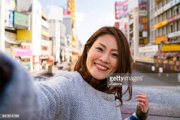 young woman taking a selfie - jgalione stock pictures, royalty-free photos & images