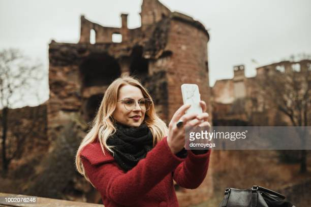 young woman taking a selfie while exploring heidelberg - baden württemberg stock pictures, royalty-free photos & images