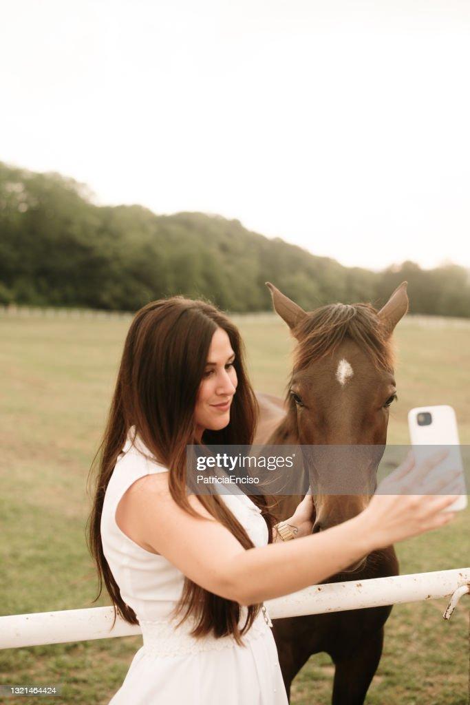 Woman Taking A Selfie Free Stock Photo - Public Domain
