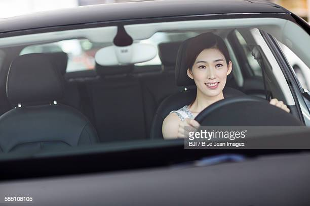 Young woman taking a test drive