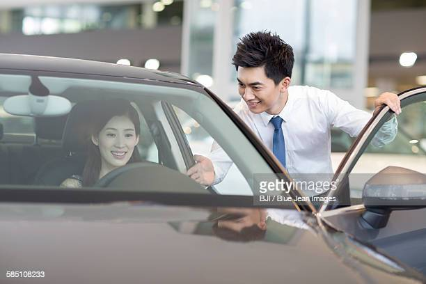 young woman taking a test drive - 試運転 ストックフォトと画像