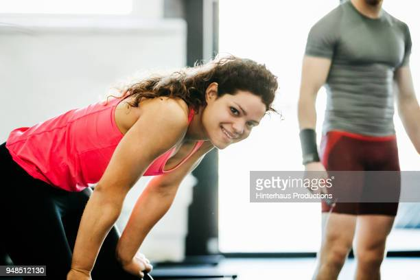 Young Woman Taking Break From Exercise At The Gym