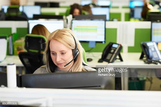 Young woman taking call in call centre