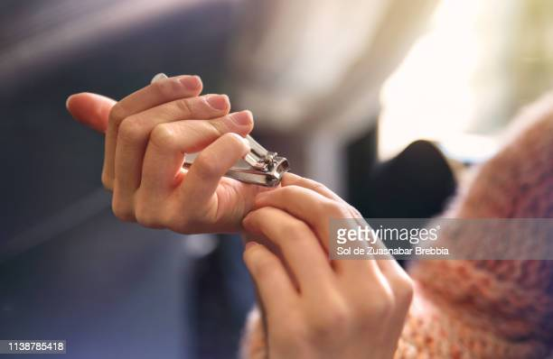 young woman taking care of her nails - fingernail stock pictures, royalty-free photos & images