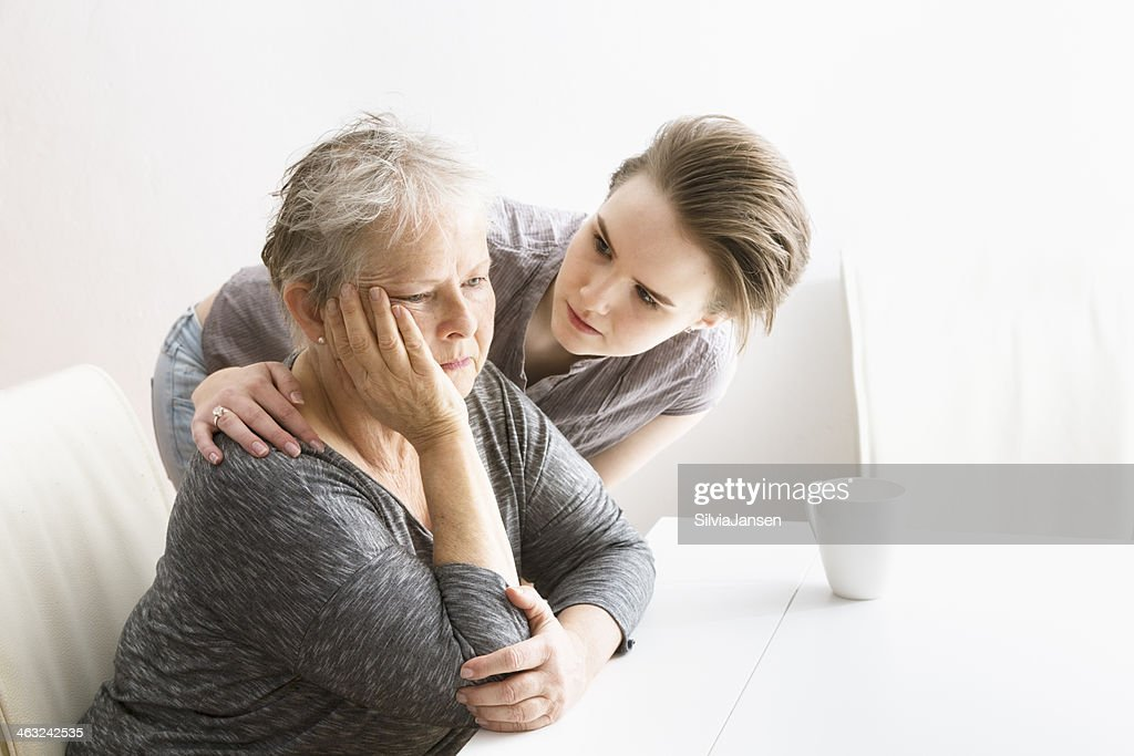 young woman taking care of senior adult : Stock Photo
