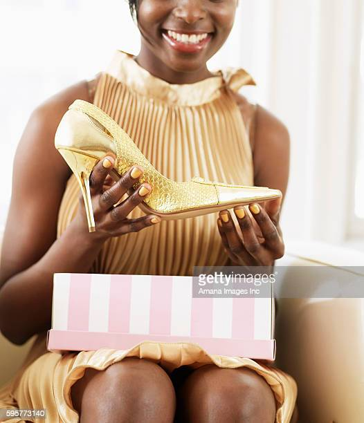 Young Woman Taking High-Heeled Shoe from Shoebox