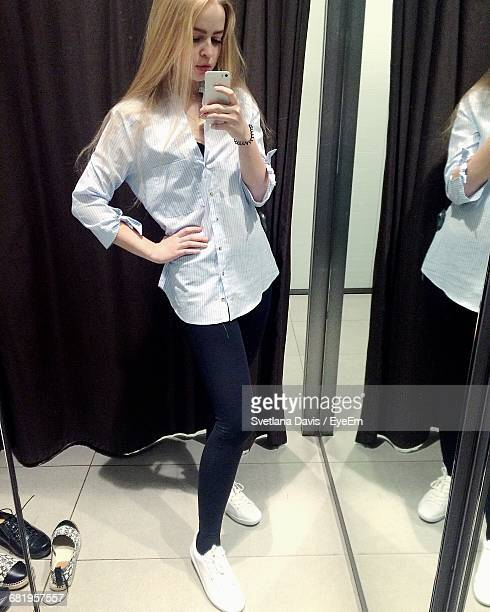 Young Woman Taking Mirror Selfie