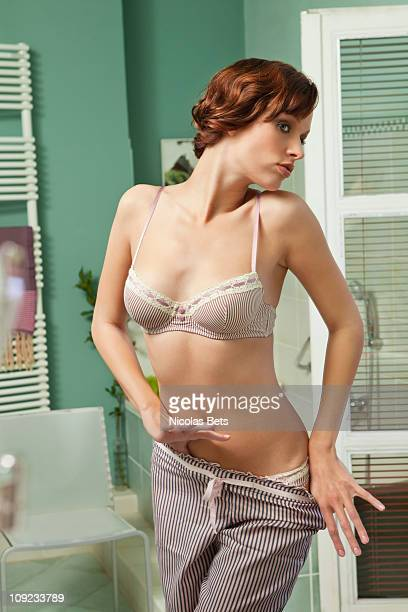 Sexy Girl Taking Off Bra Premium Pictures, Photos,  Images - Getty Images-8632