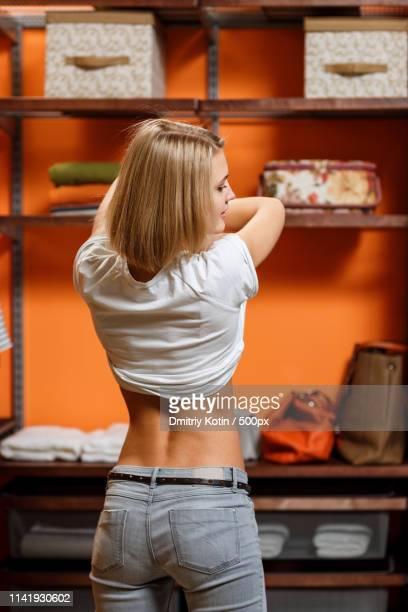 young woman taking off shirt - förförisk kvinna bildbanksfoton och bilder
