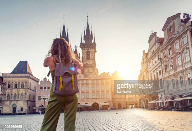 young woman taking photo from the tyn church in prague - prague stock pictures, royalty-free photos & images