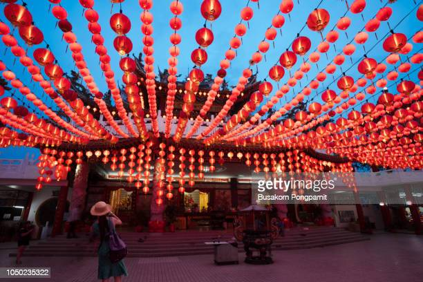 young woman taking photo with  taking photograph the lamp from mobile phone at the thean hou temple is a landmark kuala-lumpur at evening, malaysia - kuala lumpur stock pictures, royalty-free photos & images