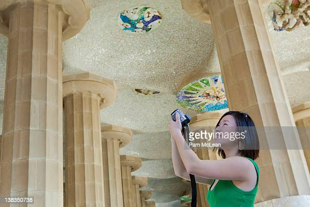 Young woman taking photos at Parc Guell