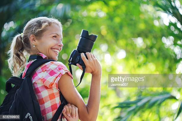 Young woman taking photos with camera