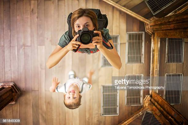 Young woman, taking picture of herself and boy