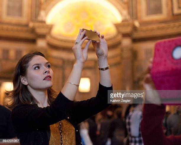 young woman taking pictures at the Pantheon, Rome