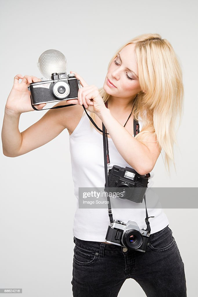 A young woman taking pictures : Photo
