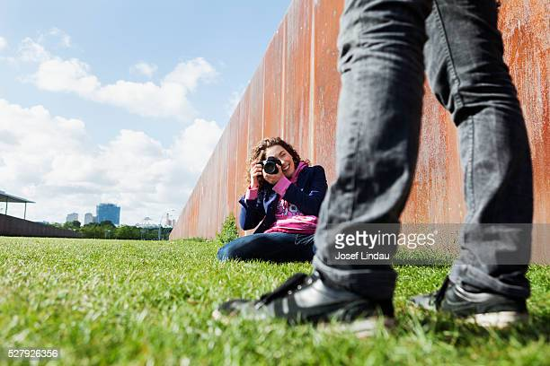 Young woman taking pictures with digital camera