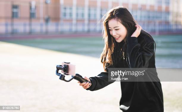 young woman taking selfie at outdoors - 安定 ストックフォトと画像