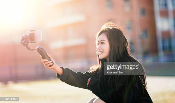 Young woman taking selfie at outdoors