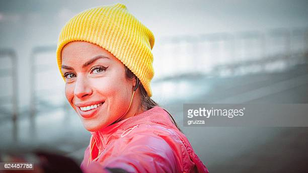 Young woman taking selfie during her sports training