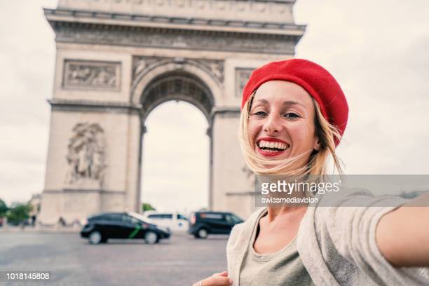 young woman taking selfie in paris city using mobile phone, people travel city capital concept in paris france - champs elysees quarter stock pictures, royalty-free photos & images