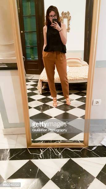 young woman taking selfie in the mirror - mirror selfie stock pictures, royalty-free photos & images