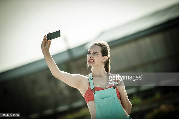 young woman taking selfie - chest kissing stock photos and pictures