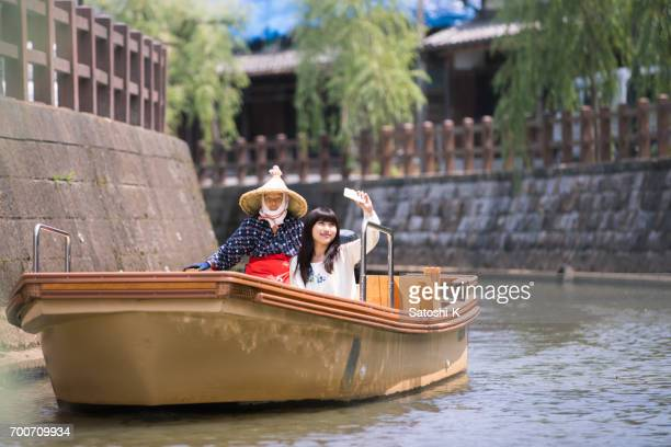 Young woman taking selfie picture on sightseeing boat