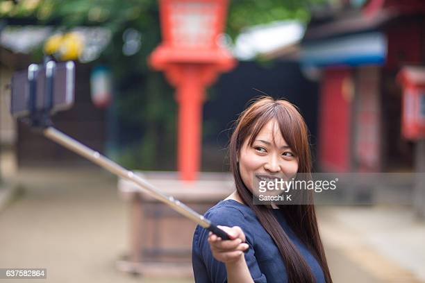 Young woman taking selfie pictures in old Japanese village