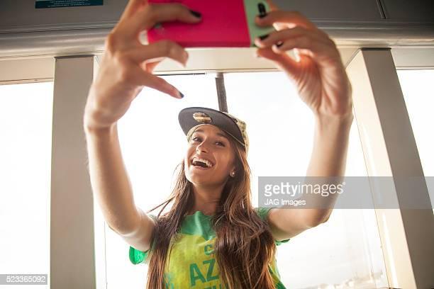 Young woman taking selfie, Rio de Janeiro, Brazil