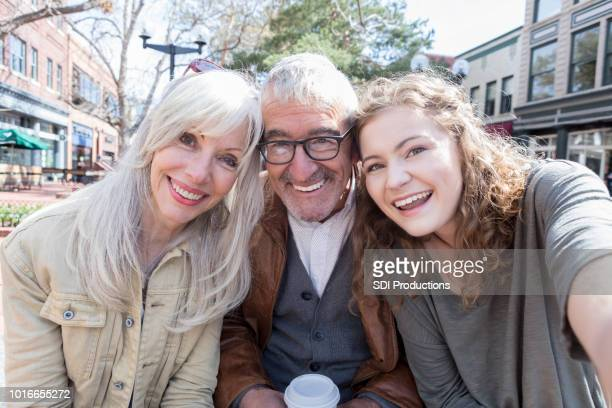 young woman taking selfie with grandparents - camera point of view stock photos and pictures