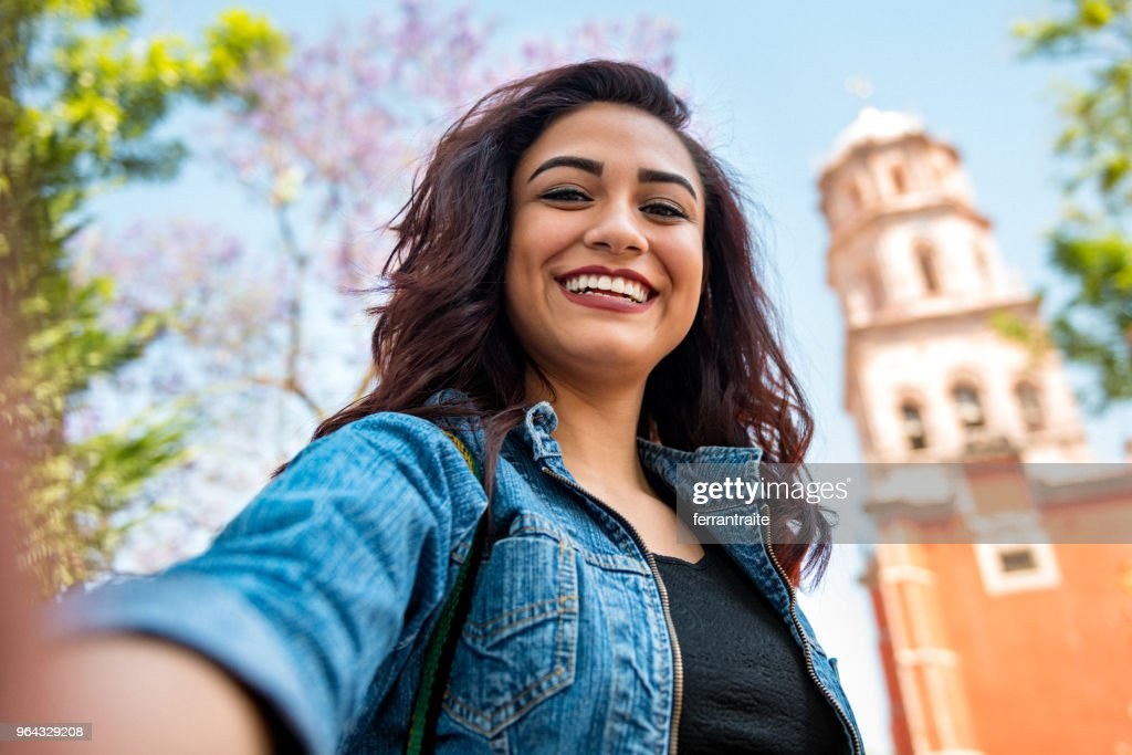 Young woman taking selfies in Mexico : Stock Photo