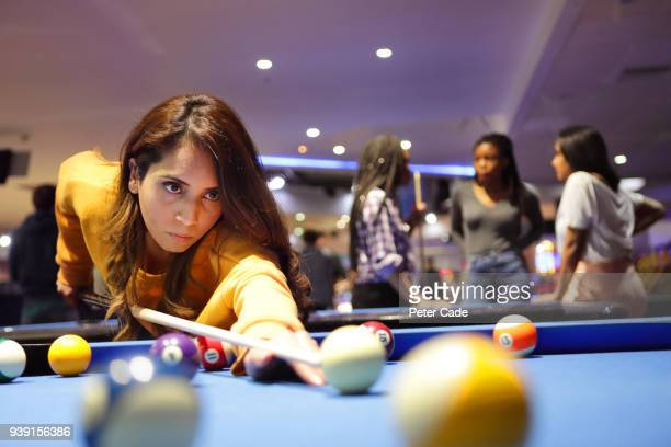 young woman taking shot on pool table - nightlife stock pictures, royalty-free photos & images
