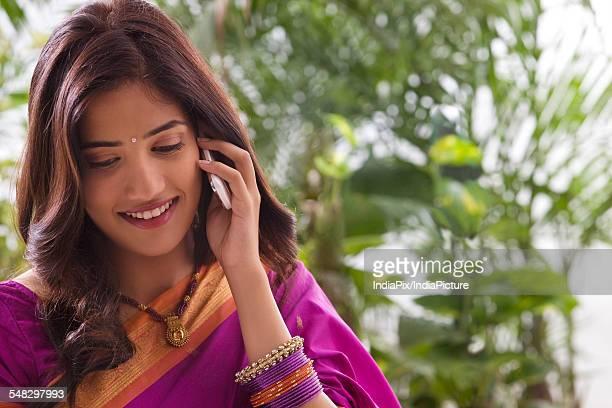 young woman talking on a mobile phone - mangala sutra fotografías e imágenes de stock