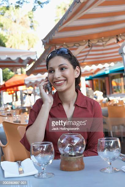 Young woman talking on a mobile phone smiling