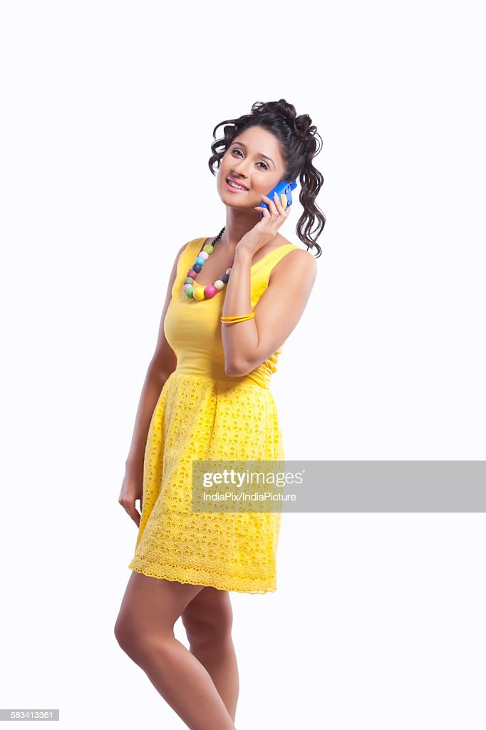 Young woman talking on mobile phone : Stock Photo