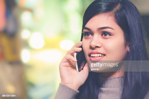 Young woman talking on mobile phone.
